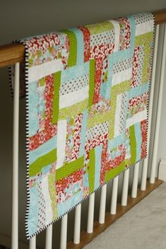 Jelly roll quilt: red, teal, green and pink