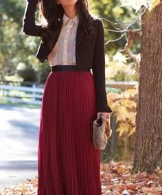 Red pleated maxi skirt, pink shirt, and black bolero