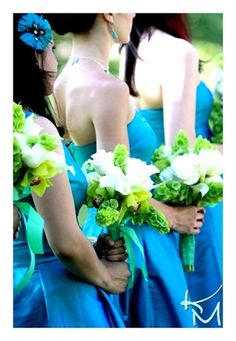 Teal Bridesmaid Dresses from Aria.  Green and White Bouquets  by Jill Van Vilet.  Coordination by Velasco Events.  Photography by Kimberlee Miller.