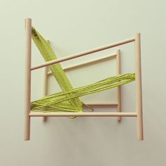 Using rope to incorporate textile techniques at a magnified scale, the Loom Chair, created by Laura Carwardine, combines the use of soft and hard materials frequently used in factory production. The seat and back support for this lounge chair are created from one continuous piece of orange rope, wrapped over a wooden dowel rod structure, as you would see in a traditional cloth loom. (6)