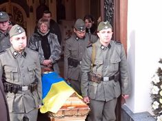 A funeral with Ukrainian soldiers in Nazi uniforms. 1943 you ask? No, 2014.