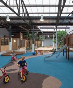 The childcare centre is set up like a street – the playrooms act as private addresses and the playground is the communal village green.