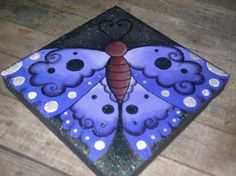 My painted butterfly stepping stone. personalized mine with the little glitter paint. Only 4 more to go and ill post them later Painted Stepping Stones, Painted Pavers, Painted Rocks, Mosaic Flower Pots, Mosaic Garden, Pebble Mosaic, Stone Mosaic, Stone Painting, Diy Painting