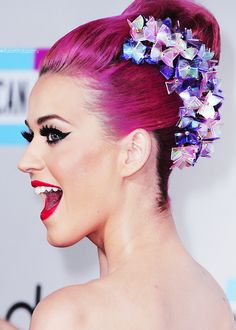 DO steal Katy Perry's look for a holiday party with thick cateye liner, 2 pairs of falsies and fire-red Retrofuturist lipstick.  iheartkatyperry:     American Music Awards 2011 - Red Carpet