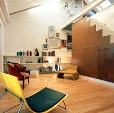 Chic Room Design Layout for Family Home: Fascinating Interior With Long White Shelves And Unique Chairs On The Wooden Floor In Departamento ...