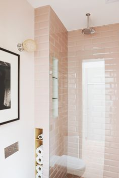 A retro home in Melbourne uses pink subway tile in the shower