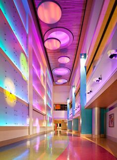 Light wall corridor connecting the new tower to the East building at Phoenix Children's Hospital.