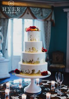 Four tier wedding cake with gold foil leafs by PPHG pastry chef Jessica Grossman at The William Aiken House in Charleston, South Carolina | Photo by Hyer Images