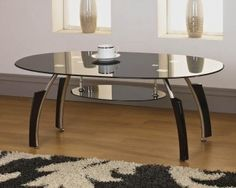 IFC Black Glass Oval Coffee Table  https://www.tradepricefurniture.co.uk/ifc-black-glass-oval-coffee-table.html
