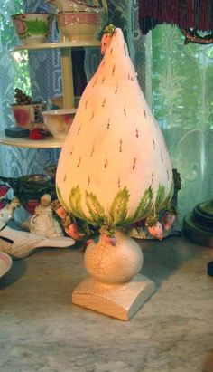 Giant Strawberry Make-Do Pincushion Upon A Wooden Candlestick.