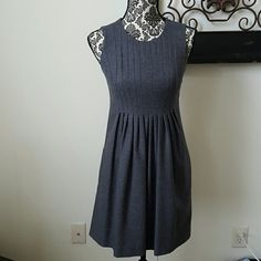"""NWOT Charcoal Dress NWOT! Charcoal colored empire waist dress.  Has Pockets!  97% Wool 2% Spandex.  Hits just above the knee.  Perfect for work or an event! Model is 5'3"""" and 100lbs. Banana Republic Dresses Midi"""