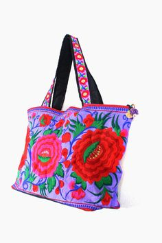 """This beautiful Bag is made with an amazing piece of Embroidered fabric woven by the HMONG hill tribes of Lanna Country (Northern Thailand). Its a great bag for carrying anything while on the go! It features a zippered opening area with Pom Pom zipper pull and inside zippered pocket. #ethniclanna   Length - 16.5"""" Height - 14"""" Pon Pon Strap - 24"""""""