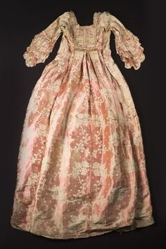 """Salmon pink silk dress, worn by Eliza Lucas Pinckney, c. 1760s-1770s. It is said to be the dress Eliza wore when presented at court in London. Unfortunately, this garment is in very fragile condition, so could not be included in the """"Charleston Couture"""" exhibit. From the collections of the Charleston Museum."""