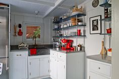 Simple kitchen - love the red accents!