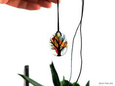 Tree pendant / necklace tree jewelry multi by EerinVinkArts.  Eerin Vink is an illustrator and artist. She also makes jewelry. You can find this artist on Etsy: https://www.etsy.com/shop/EerinVinkArts.