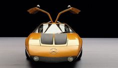 "Mercedes-Benz presented the C 111 at the 1969 Frankfurt International Motor Show. With its wedge-shaped plastic bodywork, gullwing doors and rotary-piston - or Wankel - engine, the ""research lab on wheels"" surprised and intrigued visitors. The C 111 was and remained an experimental car. The model shown here is a further developed version from 1970.   Rotors 4. Chamber volume 146 cu in. Output 350 hp (257 kW)  at engine speed 7000/min."