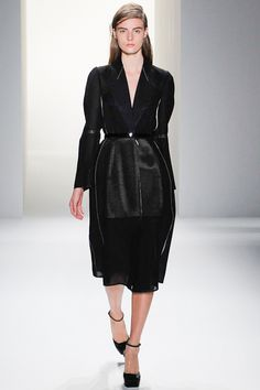 """Look 4 Calvin Klein Collection Spring 2013 """"Francisco Costa: It was a combination of [Alberto] Vargas, the artist, a lot of his erotic pictures, mixed with Carolyn Bessette Kennedy's essence of how to dress, and how to dress in an urban environment. She dressed in a really interesting, intellectual way, she wore a lot of Japanese clothes and a lot of Calvin Klein. If you go back to some of the pictures she was really incredible; the precision and the waist was so chic. So between the two worlds"""""""