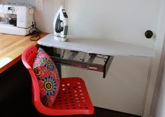 Tiny workspace for a crafter/designer with my favorite feature - a hidden, pop-up ironing board