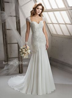 Beautiful lace wedding dress with flowing skirt, Summer by Sottero and Midgley. Finished with detachable lace cap-sleeves and romantic sweetheart neckline.