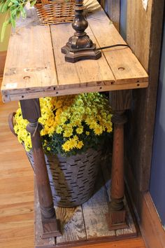 Love the table....for a sofa table...rough wood, spindles...Nice!