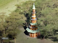 Hippo Point Wildlife Sanctuary, on Lake Naivasha in Kenya - a 115 foot tall pagoda completed in 1993 with a 360 degree observation lookout at the top;  50 feet wide at its base, the hotel offers four double rooms and a single inside the nine-story building;  Hippo Point is the eccentric folly of Michael and Dodo Cunningham-Reid, who wanted to build something special in Kenya for people to enjoy