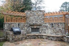 Outdoor Fireplace with Seating wall, Pergola and Outdoor Kitchen