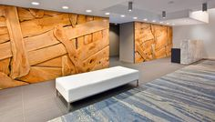 """the lobby features a two part """"woven wall"""" of western broad leaf maple slabls by artist Brent Comber. the carpet runner is a custom design by Kodu Design, fabricated by Diurne.   photography by john bentley 