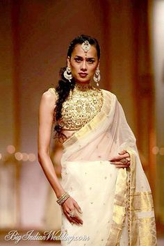 Heavily embriodered blouse with a cream bridal kerala saree gives an ethnic look. By Preeti S Kapoor. Christian Wedding Sarees, Christian Bride, Christian Weddings, Bridal Silk Saree, Saree Wedding, Indian Dresses, Indian Outfits, Kerala Saree, White Saree