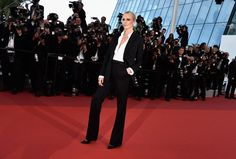 Pin for Later: Every Single Look From the Cannes Film Festival You Just Can't Miss  At The Last Face premiere, Charlize Theron suited up in Dior and accessorized with Chopard jewels.
