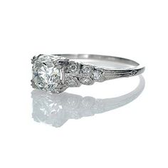 My taste isn't this expensive, but I love the look of this engagement ring :)