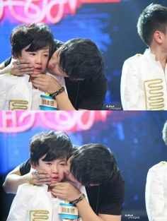 """Donghae cheering up a little boy that's crying""  *melting* be the father of my children! <3"