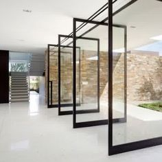Enticing Sliding Glass Door Design For Backyard Come With 4 Black Metal Modern Sliding Glass Door Frame And Stone Wall Plus White Painted Staircase Also White Ceramic Flooring a part of under Furniture