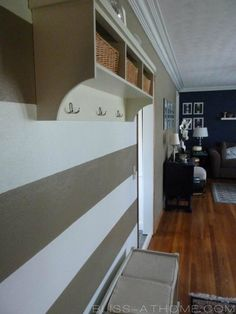 love grey and white striped accent wall with dark blue walls for a boys room.  Maybe coral for a girl?