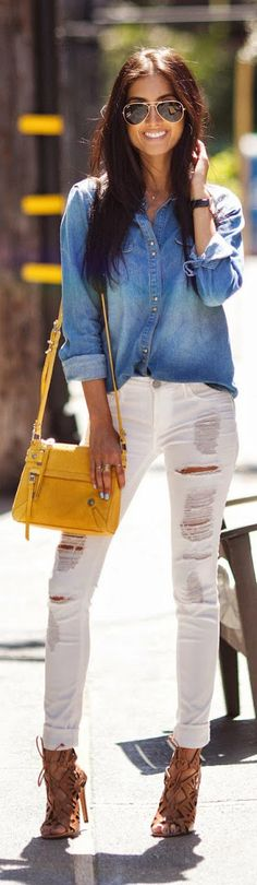 Racquel Natasha is wearing a well worn denim shirt from Zara, white ripped jeans from Black Orchid Denim, shoes from Dolce Vita and the bag is from Botkier