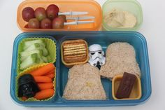 Lunch 2: **This just may be my all-time favorite Bento I've ever made.  Start Wars theme!!! Light saber skewered grapes, hummus, homegrown cucumber slices, baby carrots (with Darth Vader decoration), crackers, Darth Vader ham and cheese sandwich (with storm trooper decoration), and the pièce de résistance: a Han Solo in chocolate carbonite! Yeah, Noah really loved this one!