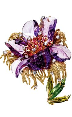 GEM-SET AND DIAMOND BROOCH Designed as a stylised flower with carved amethyst petals, the pistils set with marquise-shaped tourmalines and brilliant-cut diamonds, to the yellow gold thread fringes, the stem accented with brilliant- and single-cut diamonds and tourmaline leaves.