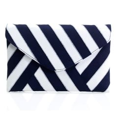 Simple and chic with accent stitching, this navy and white striped envelope clutch will have you sailing into a stylish spring.