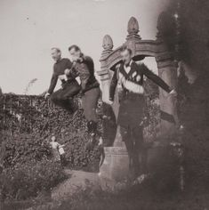 Prince Nicholas of Greece, Nicholas II, Emperor of Russia, (center) and Grand Duke Kirill Vladimirovich jumping.
