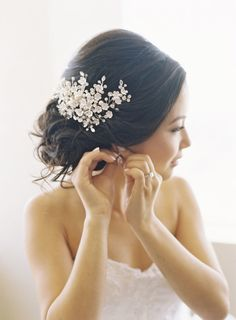 Chignon and a white floral hairpiece: http://www.stylemepretty.com/california-weddings/los-angeles/2014/04/22/modern-meets-traditional-los-angeles-wedding/   Photography: Caroline Tran - http://carolinetran.net/