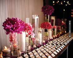 So awesome! - Grouped arrangements of single flowers at varying heights are pleasing and interesting to the eye, while candles add twinkle. @Mandy Dewey Seasons Hotel Toronto | CHECK OUT MORE IDEAS AT WEDDINGPINS.NET | #weddings #escortcards #weddingescortcards #coolideas #events #forweddings #ilovecards #romance #beauty #planners #cards #weddingdecorations