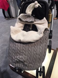 JJ Cole will introduce an adorable cable-knit footmuff in August 2016. Image Source: POPSUGAR Photography