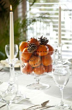 If you've had enough of paper turkeys, it's time to get more creative with your Thanksgiving decorations. Browse 35 chic Thanksgiving decorating ideas for your best holiday celebration yet. Winter Centerpieces, Thanksgiving Centerpieces, Rustic Centerpieces, Christmas Table Decorations, Holiday Tables, Centerpiece Ideas, Christmas Tables, Party Centerpieces, Hosting Thanksgiving