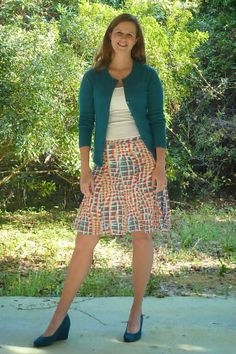 bright skirt, turquoise sweater, turquoise shoes