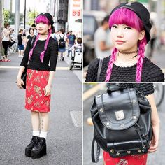 #tokyofashion 17-year-old Emily on the street in Harajuku with pink twin braids, a popcorn shirt and midi skirt from Kinji Harajuku, an MCM leather backpack, and YRU platforms.