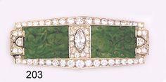 Art Deco Brooch, Carved jade, marquise-cut diamond, half moon-cut diamond,  diamond and platinum brooch. Black, Starr & Frost.Nelson Rarities, Inc., Portland, Maine