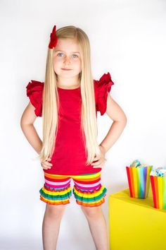 Our Rainbow Ruffled Shorts are colorful and fun! Fabric Content: 95% Cotton, 5% Spandex  Machine wash cold with like colors  Imported   Relaxed Fit / Stretchy Material   Durable   Perfect piece to layer or be worn on its own.   Please check measurements, all sales are final. No returns or exchanges.  https://adorableessentials.com/collections/shorts/products/rainbow-ruffle-shorts