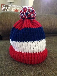 Loom knit red, white, and blue hat.