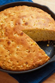 """NYT Cooking: This corn bread, adapted from the one developed by Chris Schlesinger and served at his East Coast Grill in Cambridge, Mass., is lofty and sweet, crusty and cakelike, moist and ethereal. As Sam Sifton said in the 2012 article that accompanied the recipe, it is """"the corn bread to become a child's favorite, to become the only corn bread that matters. All else is not c..."""