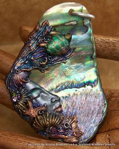 Bejeweled Mermaid Sea Turtle Goddess Pendant, BEAD, or Ornament XL Iridescent Paua Shell, Swarovski Crystals, and Polymer Clay. sculptedwindows via Etsy.