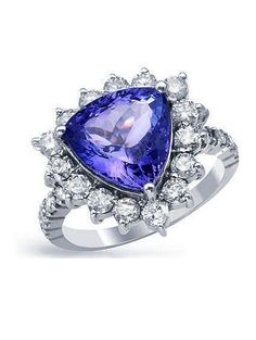 AIG Appraisal: The featured 4.98ct. tanzanite is set within a 1.38ctw. diamond bezel supported by diamond set shoulders, completed by a two millimeter wide band.  #AIG Appraisal,  #aig labs appraisal, #american international gemologists,